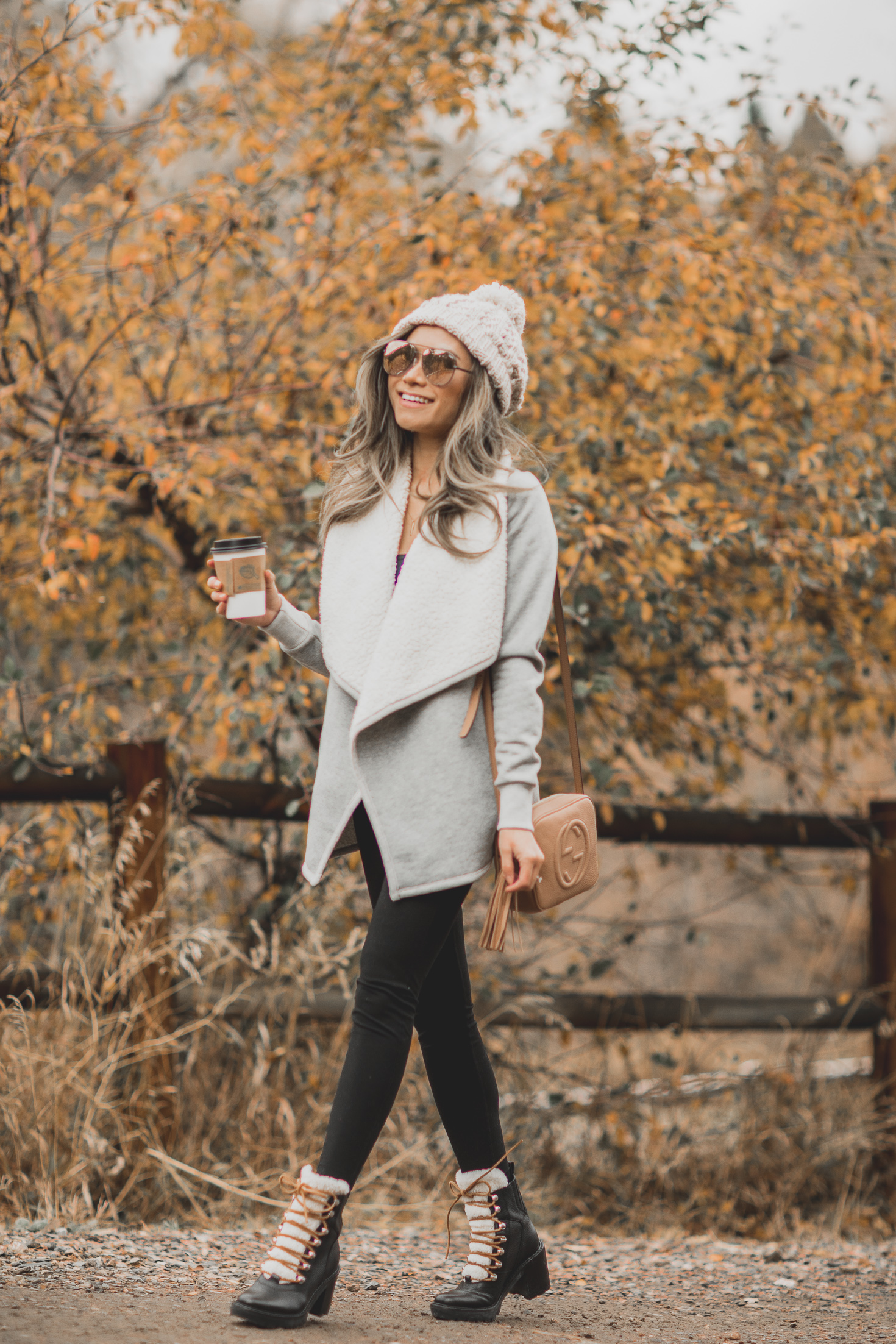 fashion blogger miss louie in abercrombie & fitch fleece cardigan, knit beanie, leggings and marc fisher combat boots