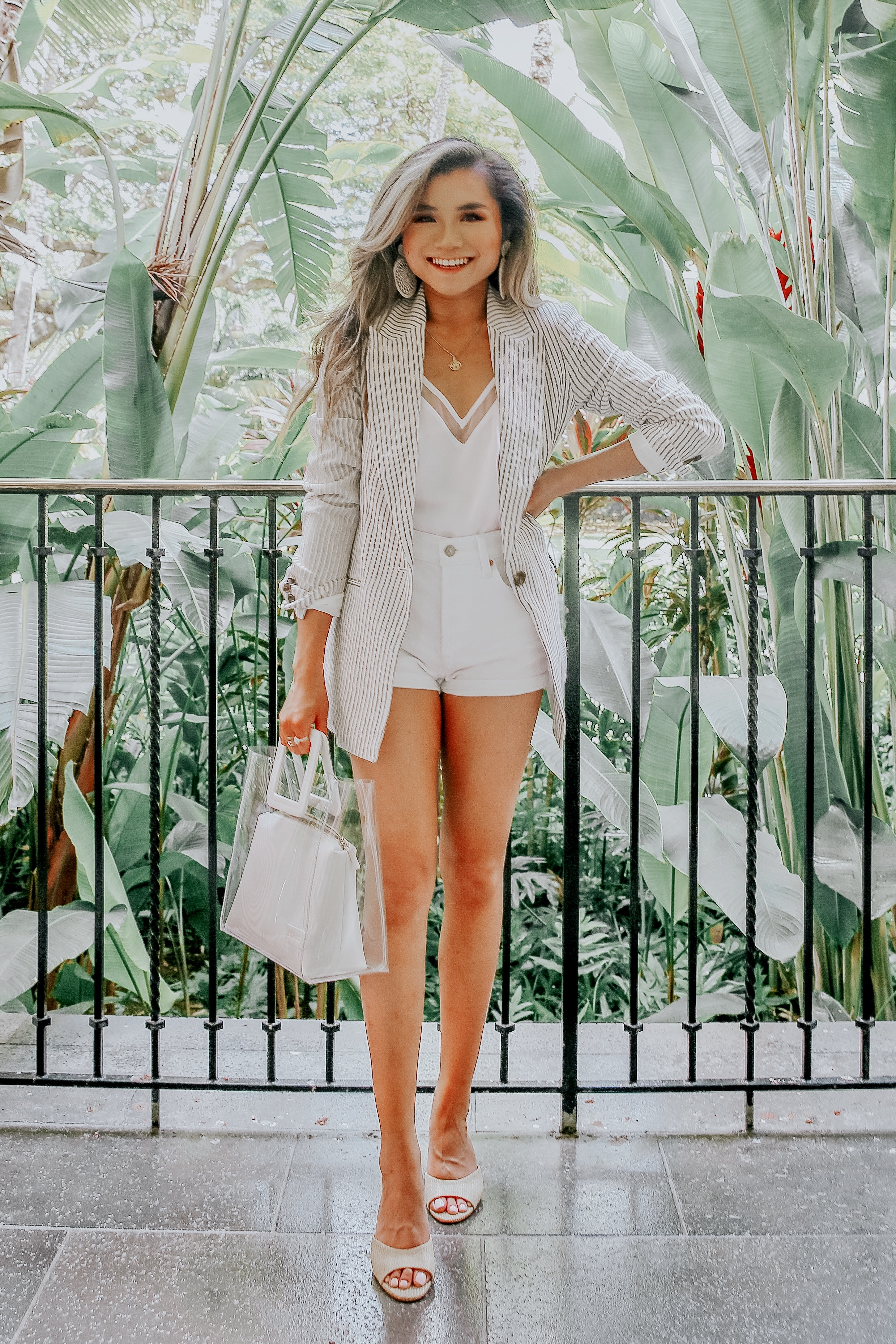 miss louie wearing summer vacation outfit with H&M lazer, staud shirley tote, express downtown cami, and steve madden erin sandals